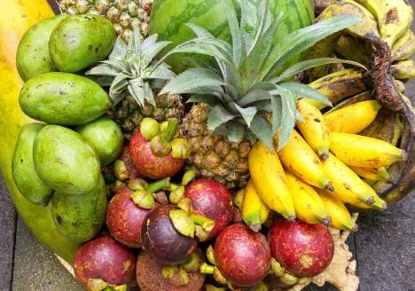 Tropical fruit Basket in Bali with pineapple, banana, mangosteen, papaya, watermelon and mango