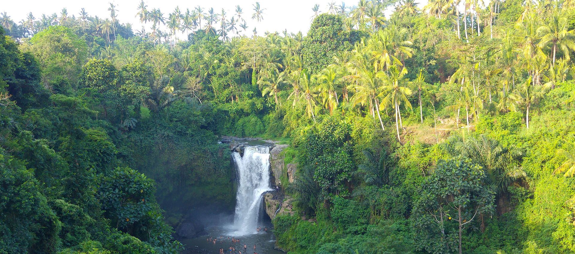 Stunning Tegenungan waterfall in the lush jungle of Bali
