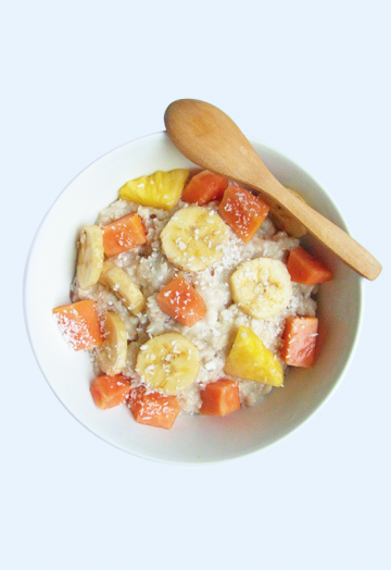 Coconut oatmeal with banana, papaya and pineapple