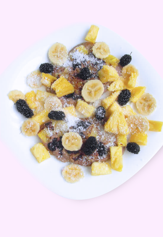 Plant-based coconut pancakes topped with fresh fruit