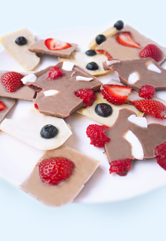 Healthy vegan chocolate bark with berries and coconut flakes