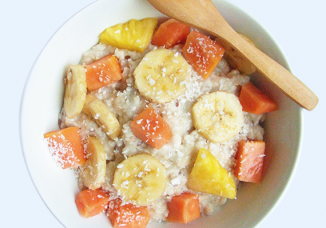 Coconut tropical fruit oatmeal with banana, papaya and pineapple