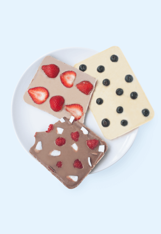 Healthy vegan chocolate bark with berries and coconut